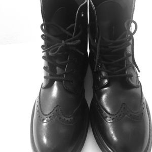 Black Wing tip ankle boots